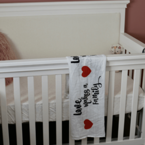 """Love Makes a Family"" Muslin Swaddle Blanket"